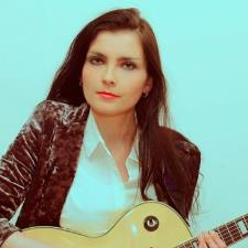Kamila C. - Experienced Berklee Scholar and Alumnus in Guitar Performance