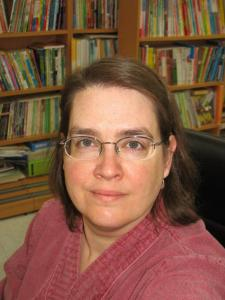 Kelly R. - Experienced English Professor with expertise in humanities